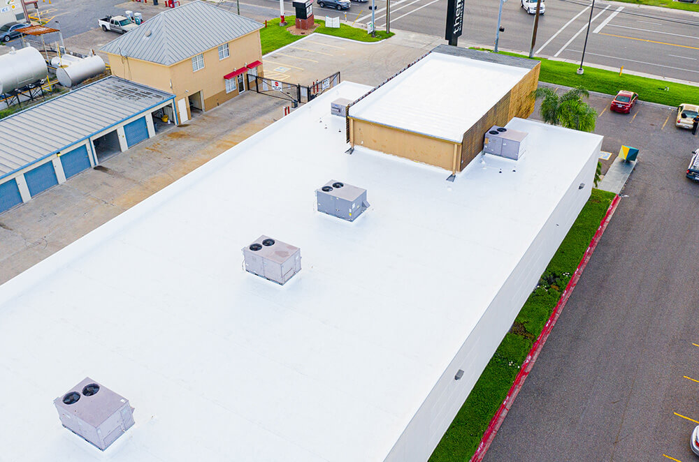 Commercial business center TPO roof membrane installation by McAllen Valley Roofing - San Antonio, TX - 001