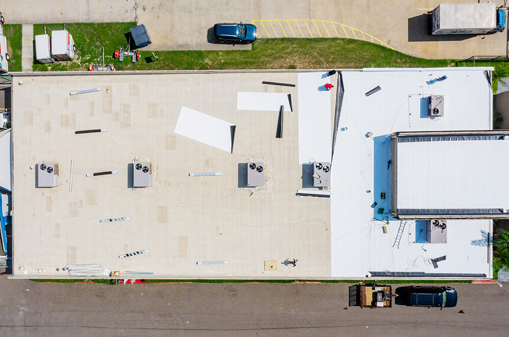 Commercial business center TPO roof membrane installation by McAllen Valley Roofing - San Antonio, TX - 002