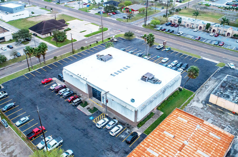 Commercial plaza acrylic roof coating restoration and installation by McAllen Valley Roofing - San Antonio, TX - 005