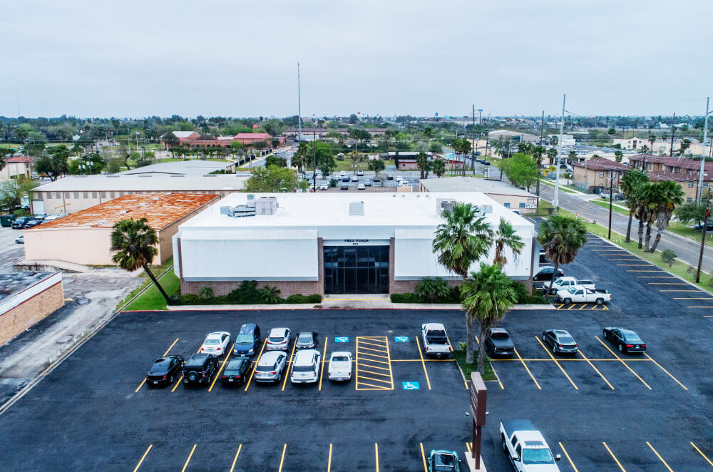 Commercial plaza acrylic roof coating restoration and installation by McAllen Valley Roofing - San Antonio, TX - 007