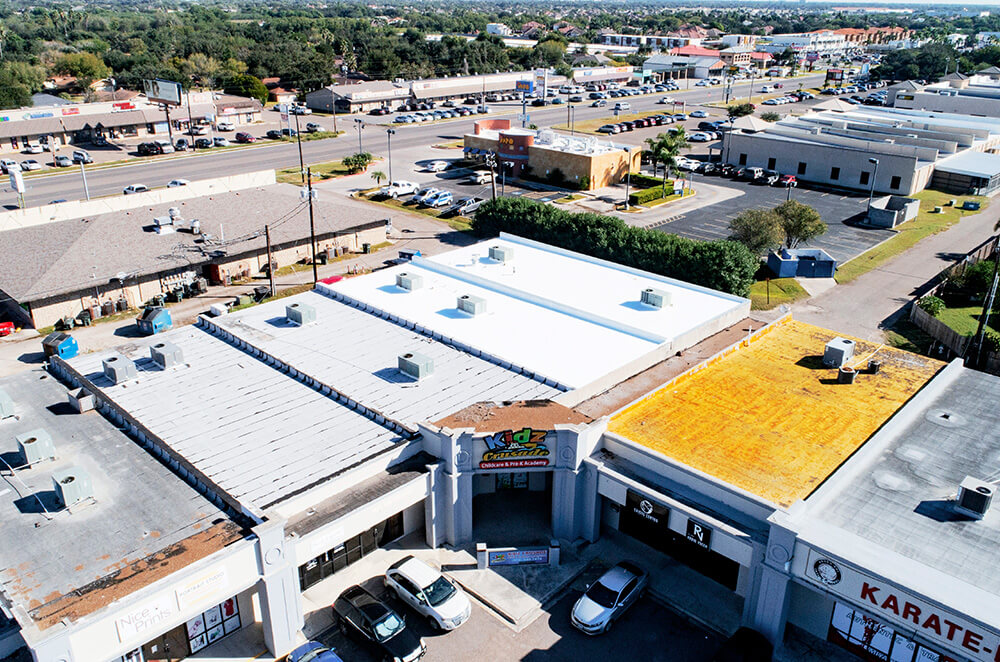 Commercial plaza silicone roof coating restoration and installation by McAllen Valley Roofing - San Antonio, TX - 001