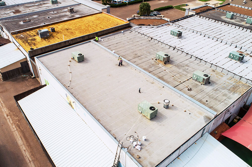 Commercial plaza silicone roof coating restoration and installation by McAllen Valley Roofing - San Antonio, TX - 003