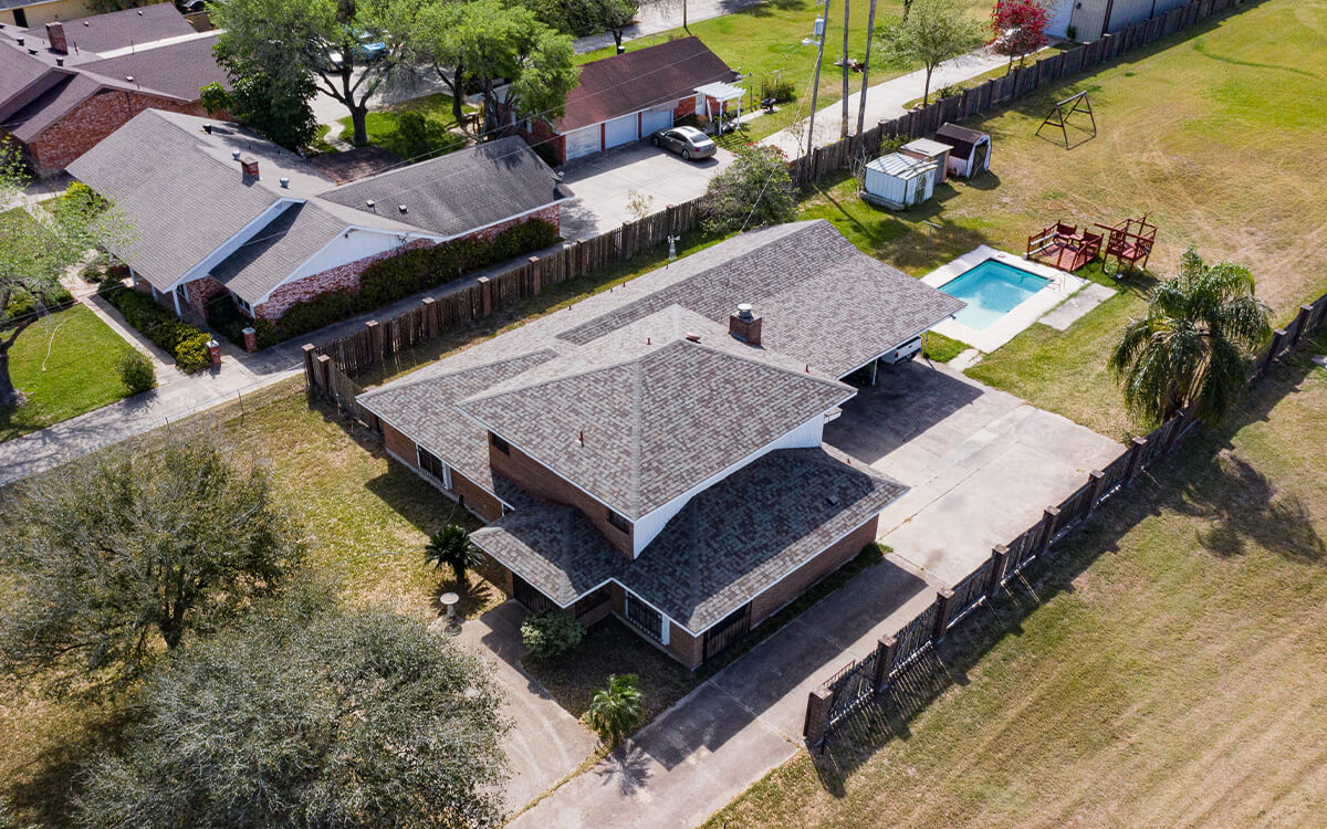 Energy efficient roof replacement shinges on a residential roof- owens corning - San Antonio Roofing Contractor B