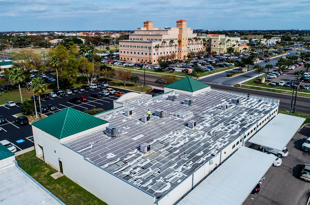 Hospital building acrylic roof coating restoration and installation by McAllen Valley Roofing - San Antonio, TX - 007