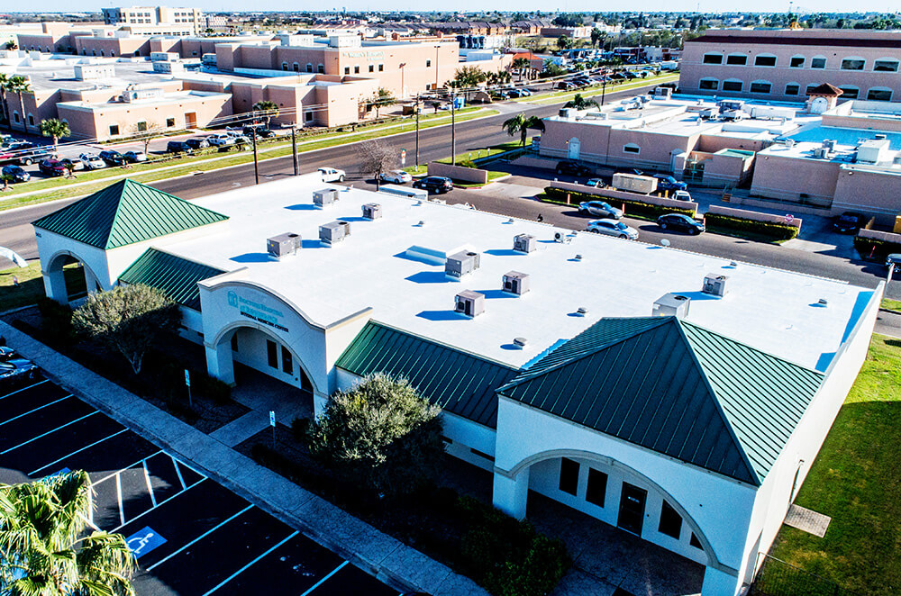 Hospital building acrylic roof coating restoration and installation by McAllen Valley Roofing - San Antonio, TX - 011